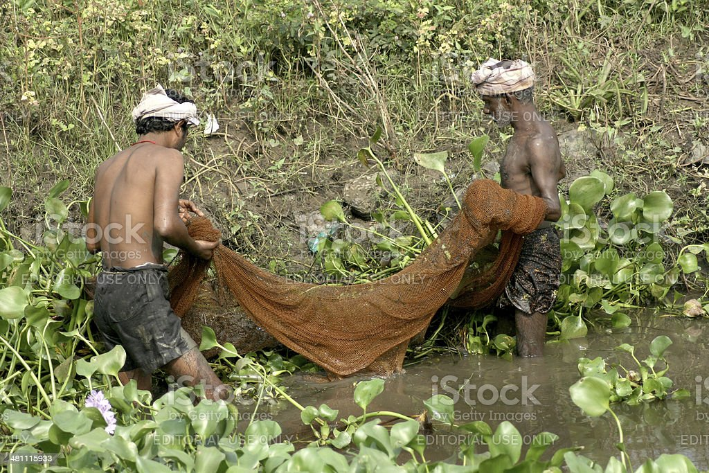 Indian Fishermen catching fish stock photo