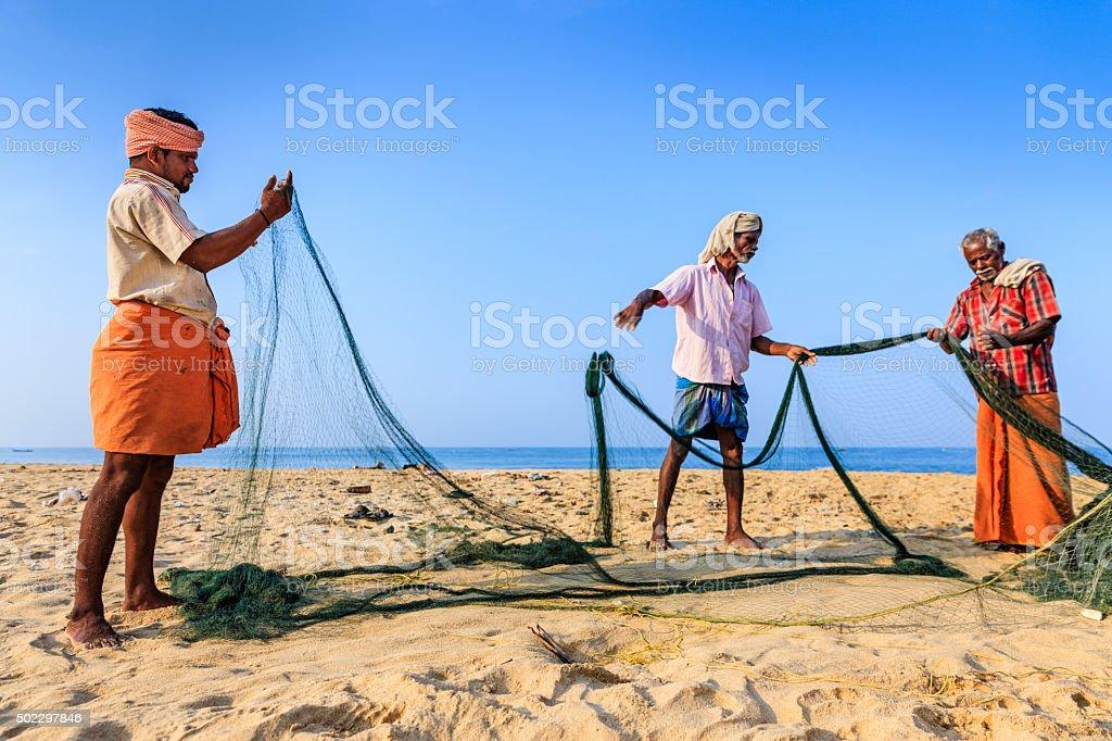 Indian fishermen preparing fishing nets, Kerala, India stock photo