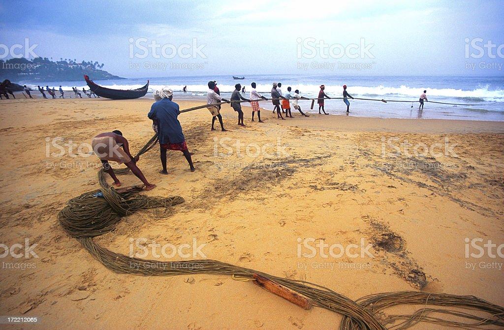 Indian fishermen pulling in big fishing net royalty-free stock photo