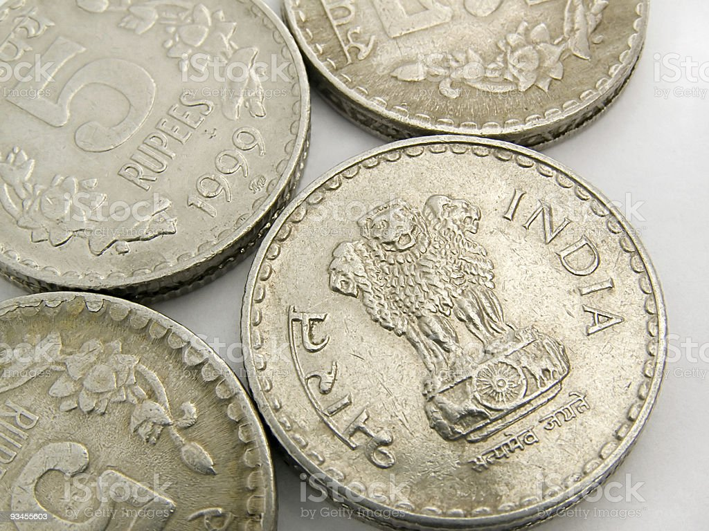 Indian five ruppes coins on white background royalty-free stock photo