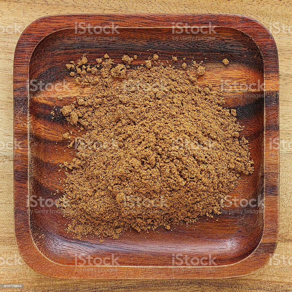 Indian five spice mix in a wooden tray. stock photo