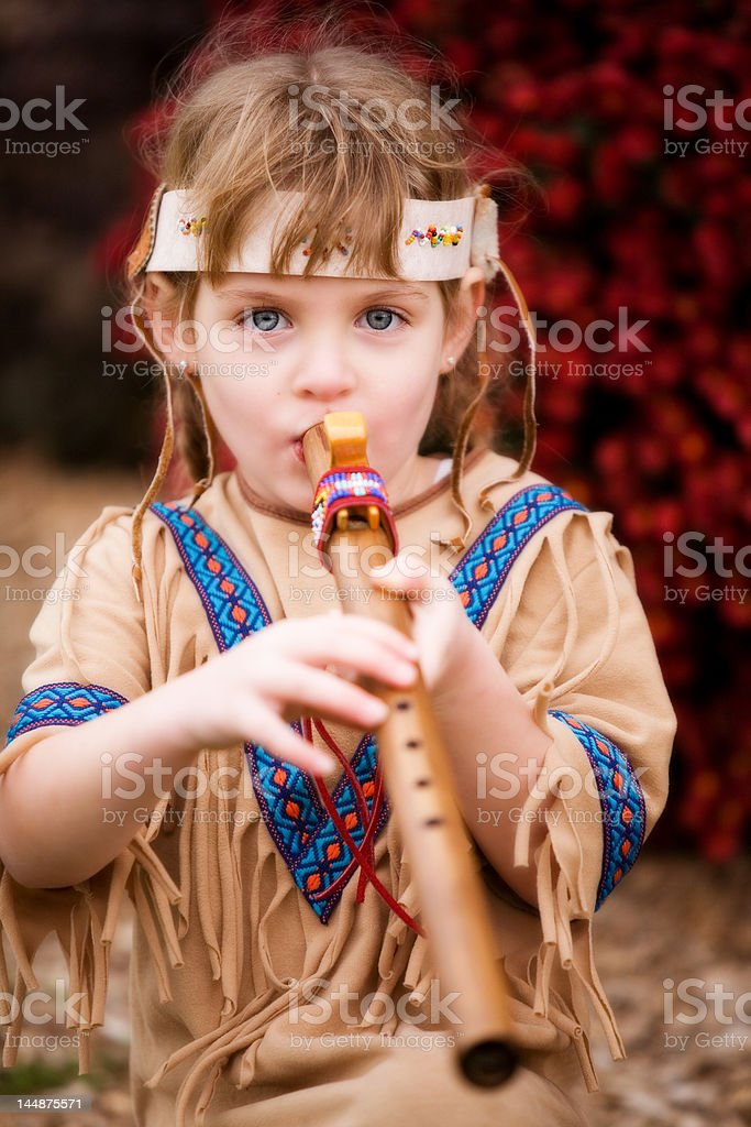 Indian Flute Player stock photo