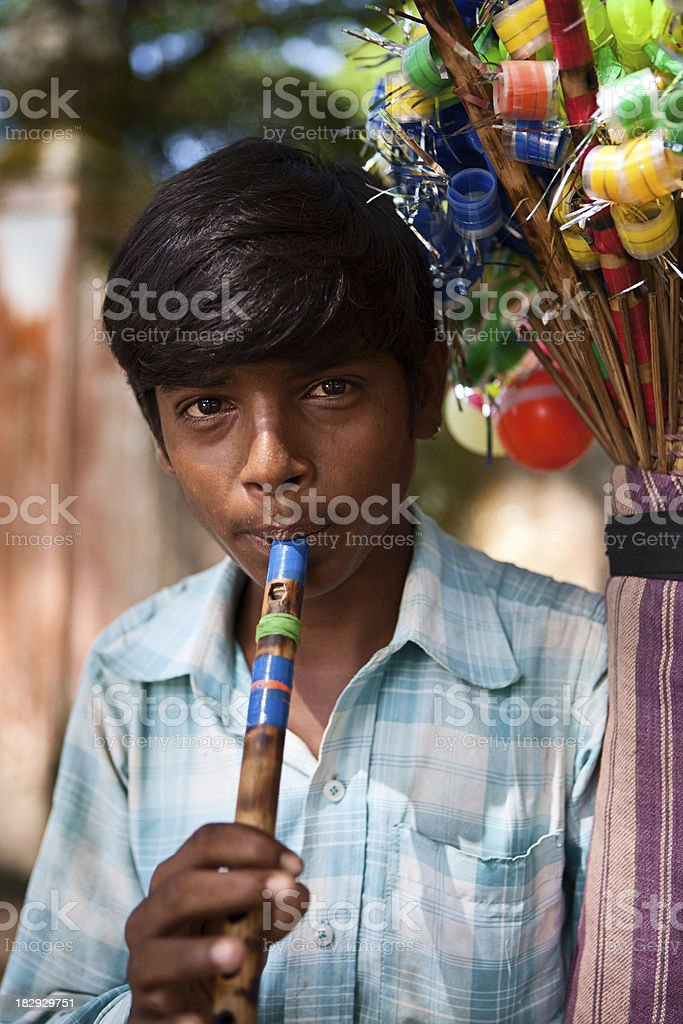 Indian flute seller royalty-free stock photo