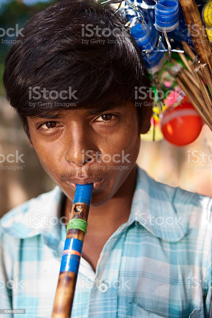 Indian flute seller stock photo