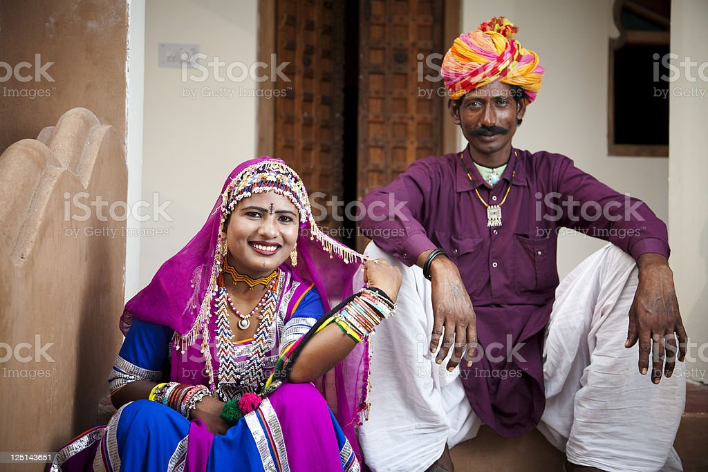 Indian Folk Dancers Sitting Outside And Looking At The Camera royalty-free stock photo