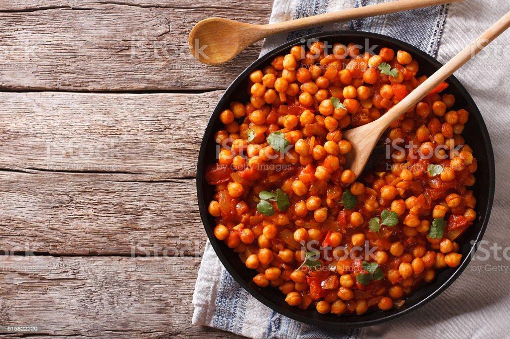 Indian Food Chana masala on a table. Horizontal top view stock photo