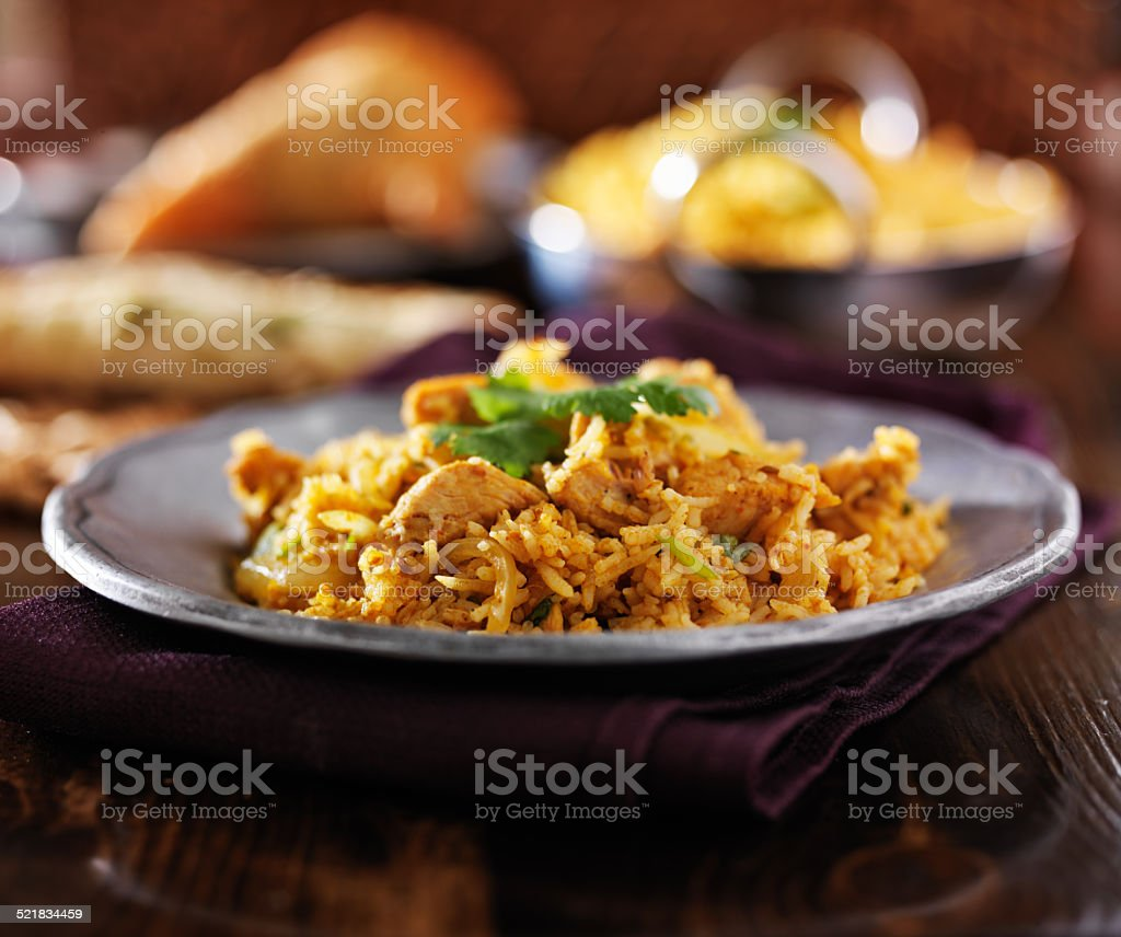indian food - chicken biryana on metal plate stock photo