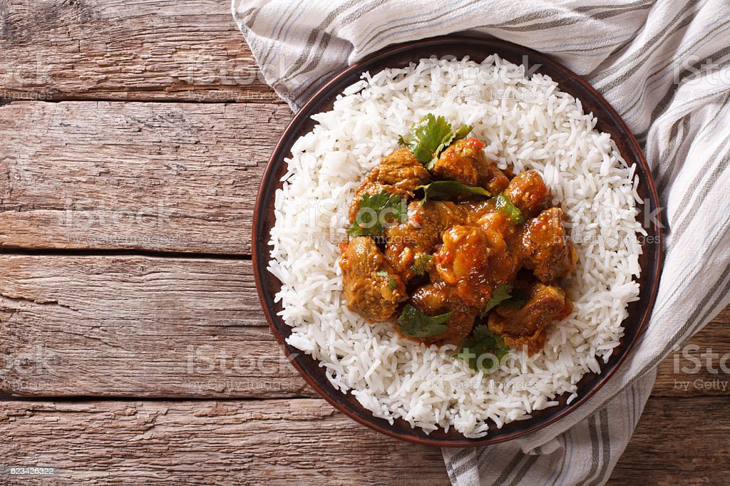 Indian food: Madras beef with basmati rice. Horizontal top view stock photo