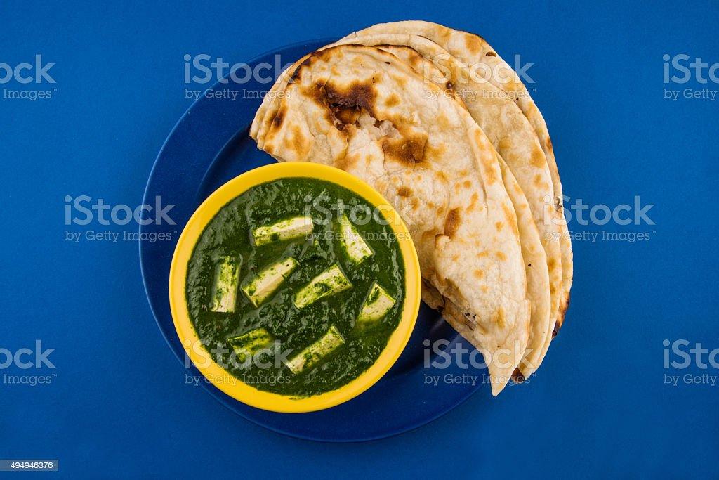 Indian food spinach or palak paneer with roti, chapati, paratha stock photo