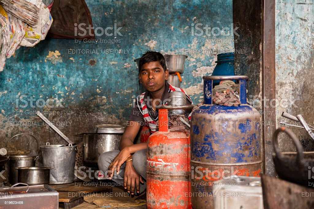 Indian food vendor inside a street kitchen, Bikaner, Rajasthan, India stock photo