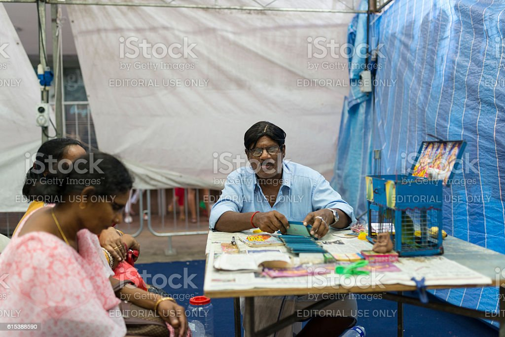 Indian Fortune Teller in Little India, Singapore stock photo