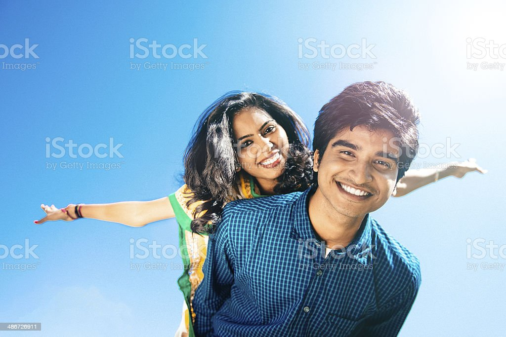 Indian Friends Piggyback stock photo