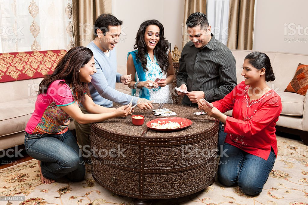 Indian Friends Playing Cards at Home stock photo