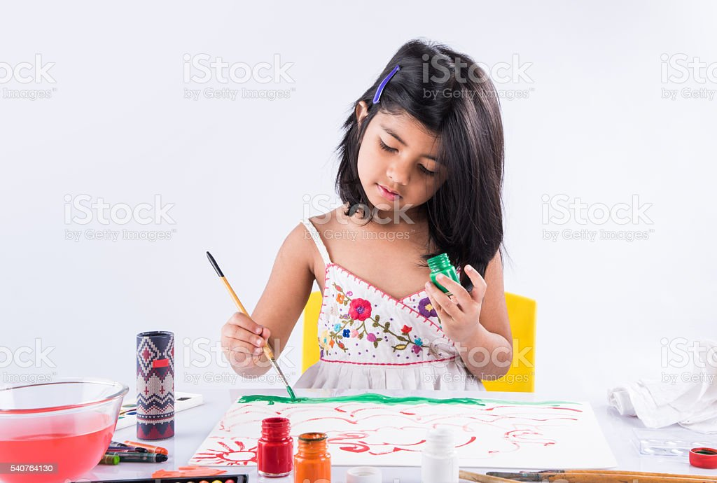 indian girl drawing, indian girl painting, asian girl colouring stock photo
