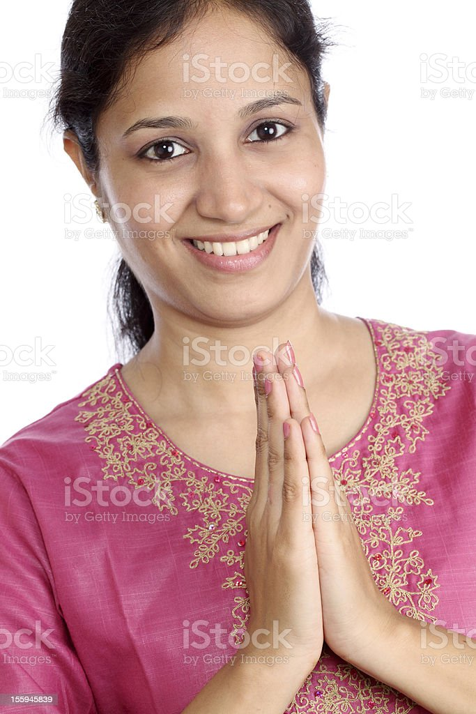 Indian girl holding hands in prayer position stock photo