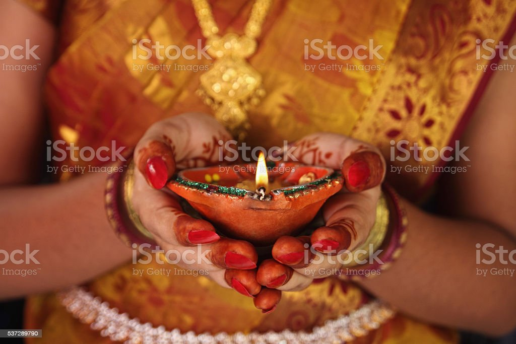 Indian Girl Holding Traditional Oil Lamp stock photo