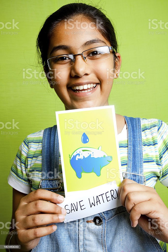 Indian girl making an appeal Save Water poster message leaflet stock photo
