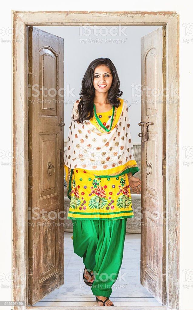 Indian Girl opening the Door stock photo