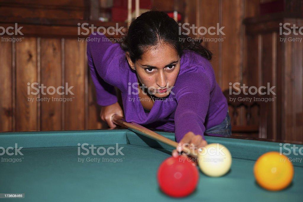 Indian girl playing pool stock photo