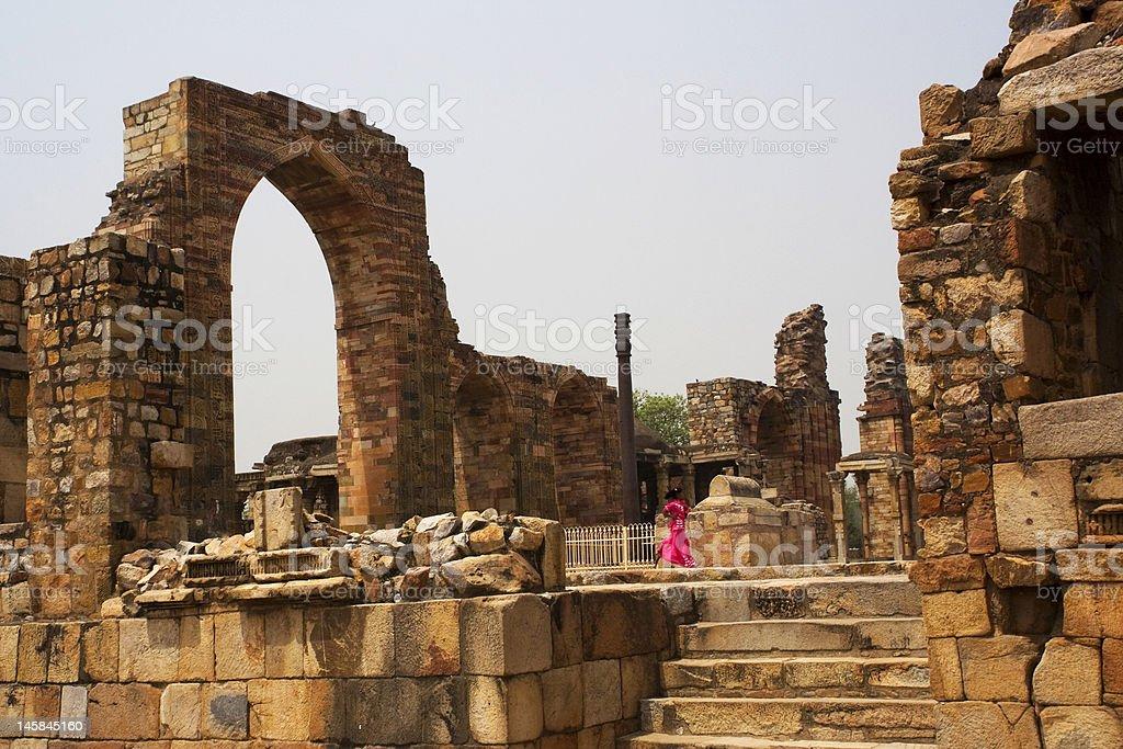 Indian Girl Running in Qutab Minar Ruins royalty-free stock photo