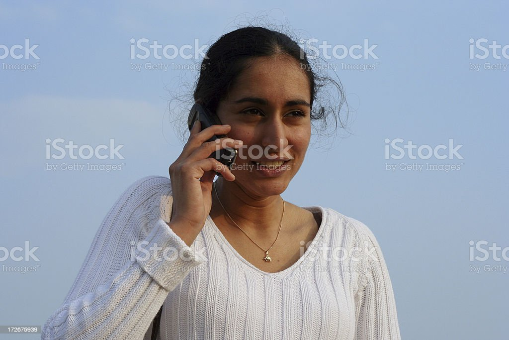 Indian girl with cell phone 2 stock photo