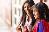 indian girls using smartphone