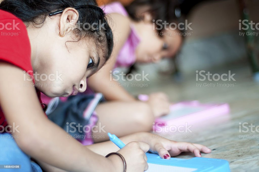 Indian girls writing on slates stock photo
