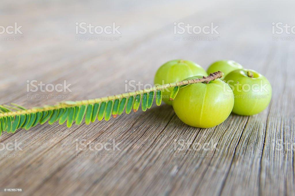Indian gooseberries on wood floor stock photo
