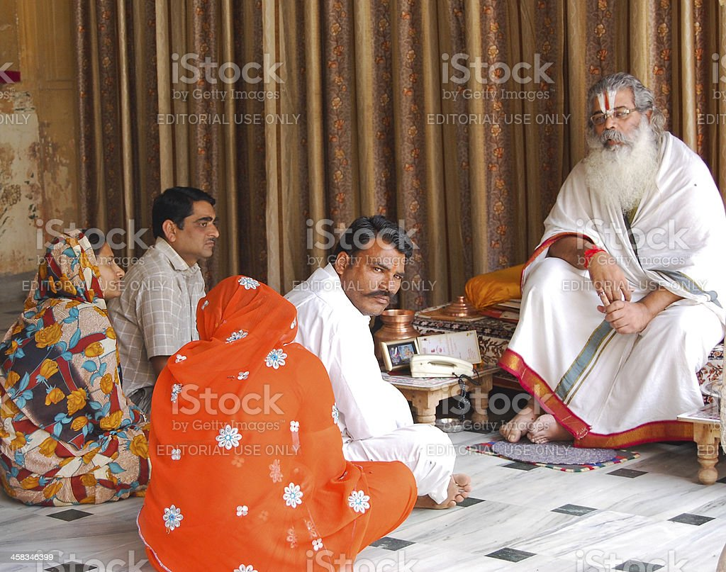 Indian Guru advising or giving lecture to a pilgrims. royalty-free stock photo