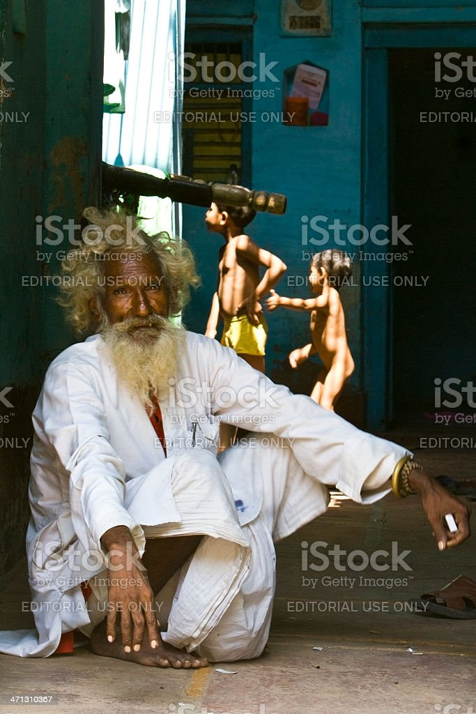 Indian Guru with nosy schoolboys royalty-free stock photo