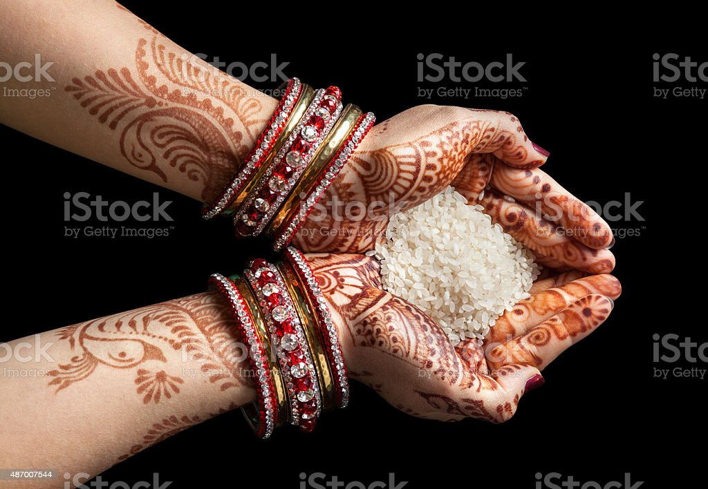 Indian hands with rice stock photo
