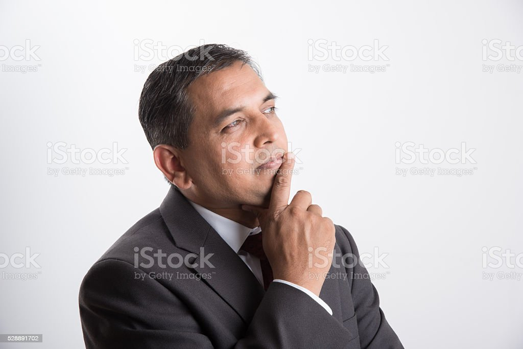 indian handsome businessman in thinking pose stock photo