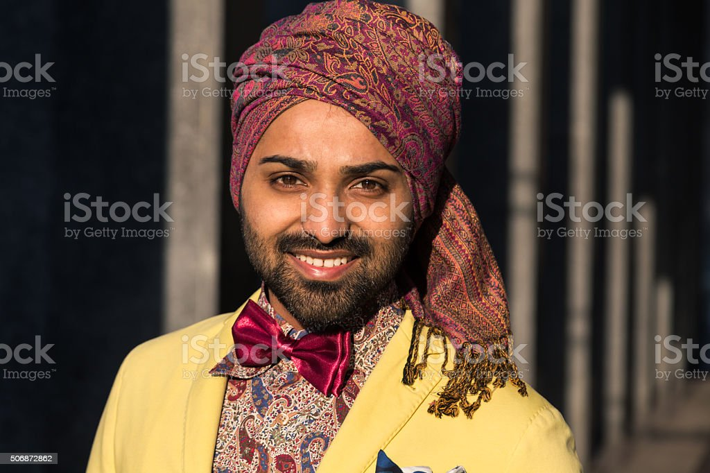 Indian handsome man posing in an urban context stock photo