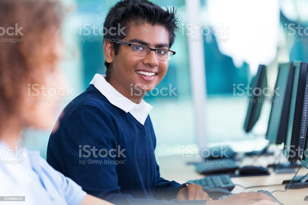 Indian high school student using computer in modern lab classroom stock photo
