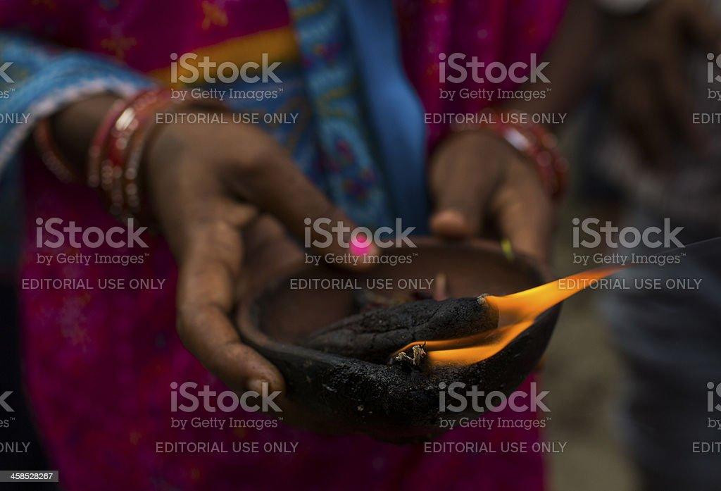 Indian Hindu Devotees light a clay pot stock photo