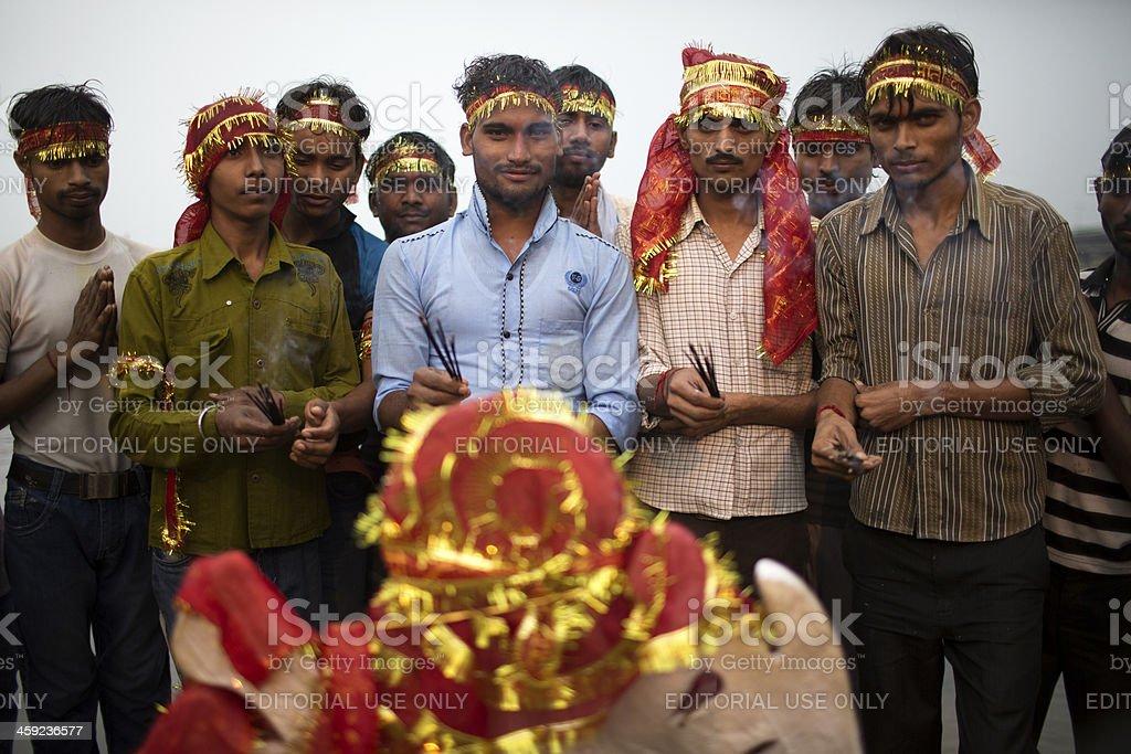 Indian Hindu Devotees pray to a Durga idol stock photo
