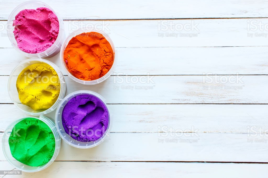 Indian Holi festival colours with wooden background text space stock photo