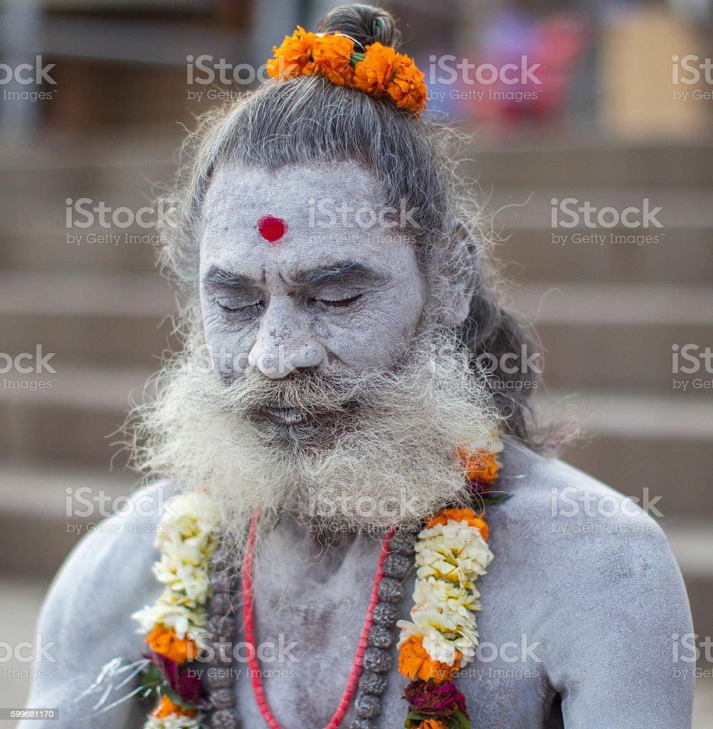 Indian Holy man meditating at Varanasi, India. stock photo