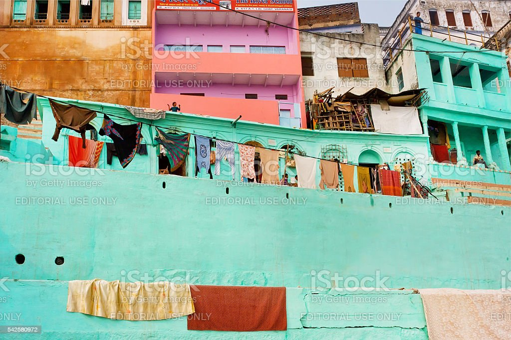 Indian homes of poor people with balconies and laundry drying stock photo