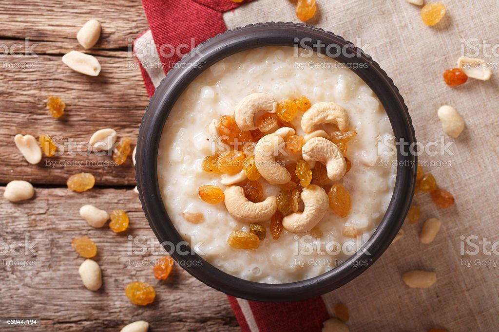 Indian kheer rice pudding with nuts and raisins close-up. horizontal stock photo
