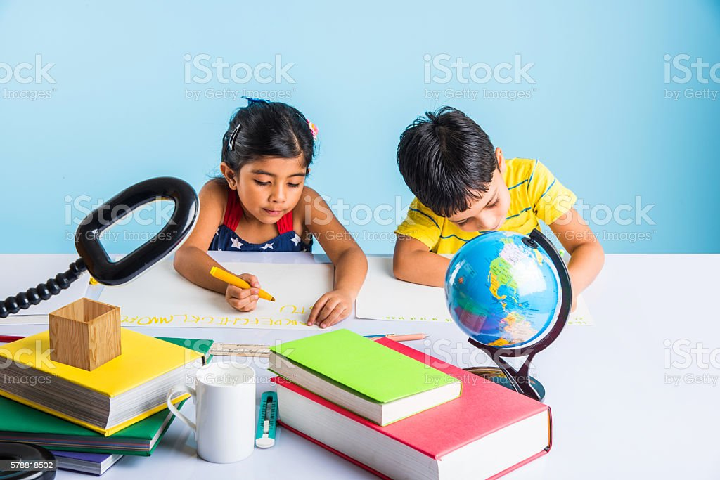 indian kids studying on study table stock photo