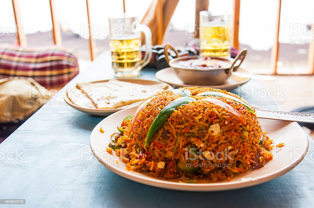 Indian kitchen dish Pulao or Pilaf with rice and vegetables stock photo