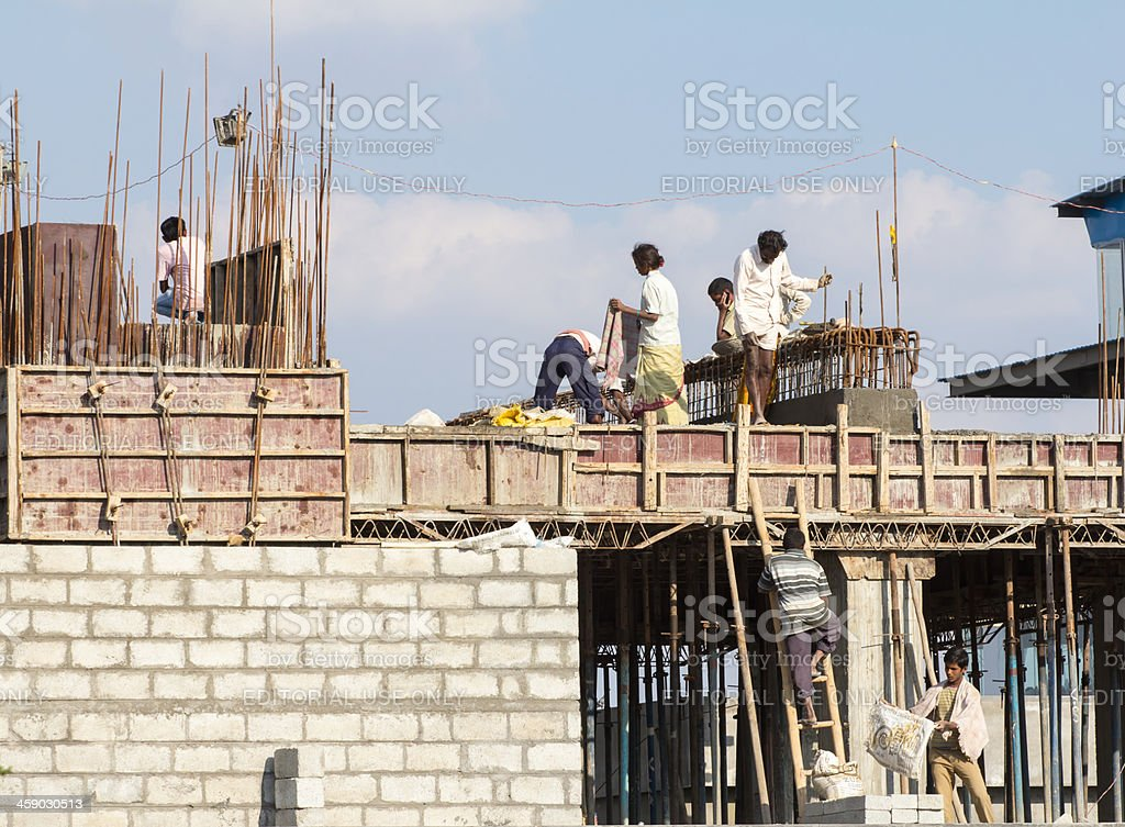 Indian laborers at construction site stock photo