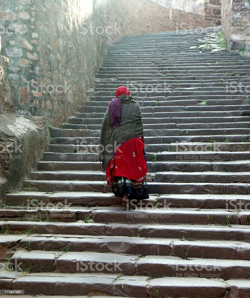 Indian lady clibing the stairs to Ranthambore Fort,Rajasthan,India royalty-free stock photo