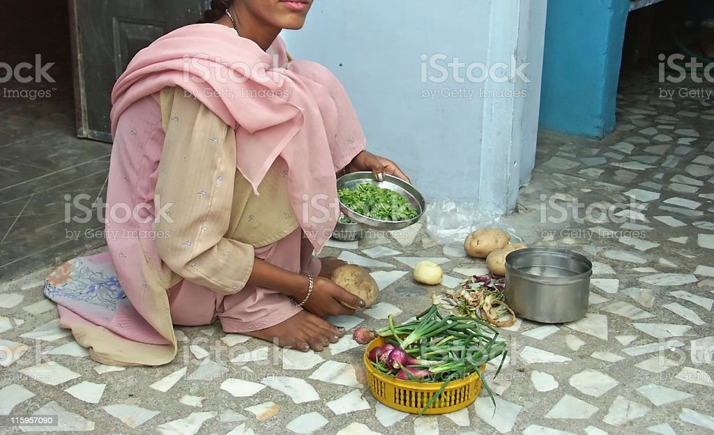 Indian lady preparing vegetarian food in kitchen,Rajasthan,India royalty-free stock photo