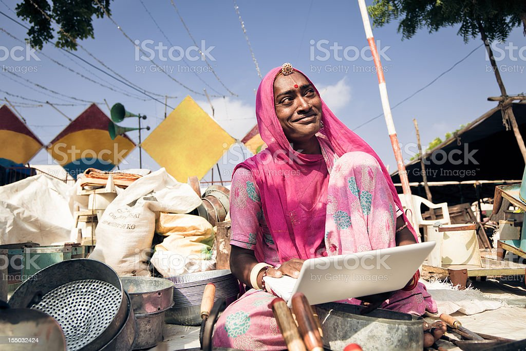 indian lady selling her pots on the internet stock photo