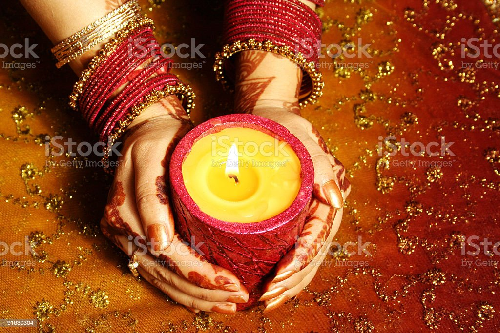 Indian lady with candle celebrating royalty-free stock photo