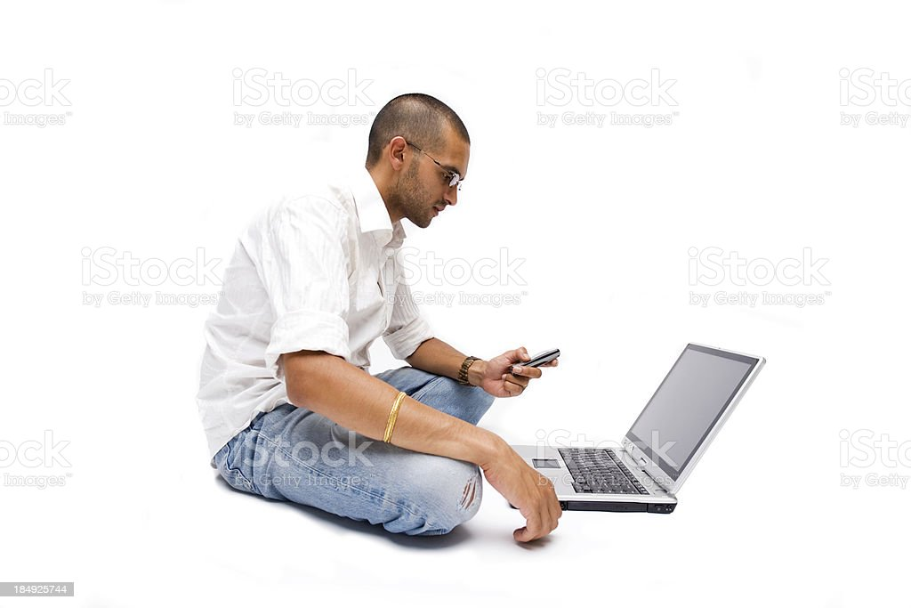 Indian Laptop Phone Man stock photo