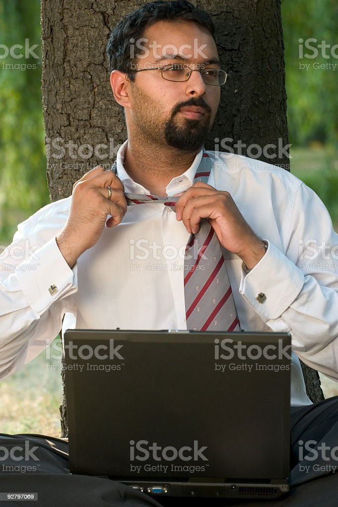 Indian loosing up the tie royalty-free stock photo