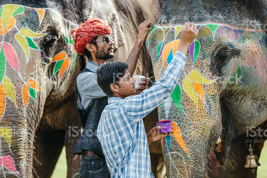 Indian mahouts decorating elephants stock photo